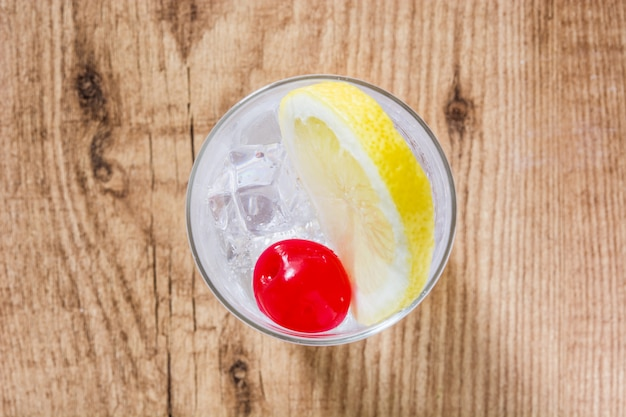 Classic tom collins cocktail on wooden table