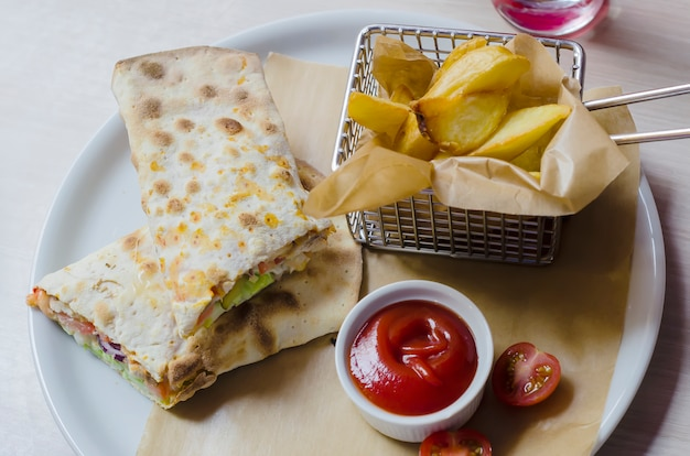 Classic tortilla wrap with filling shot on a wooden background closeup