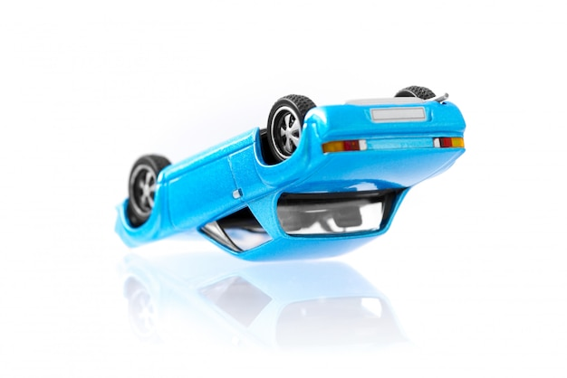 Classic toy cars accident in overturned composition with side view profile