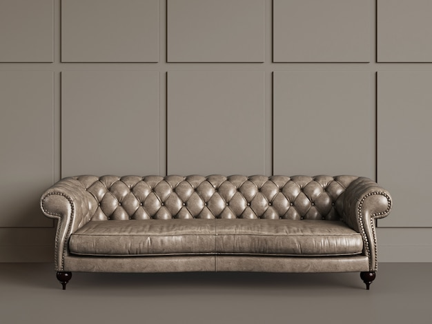 Classic tufted sofa  in empty room with beige walls.minimal concept