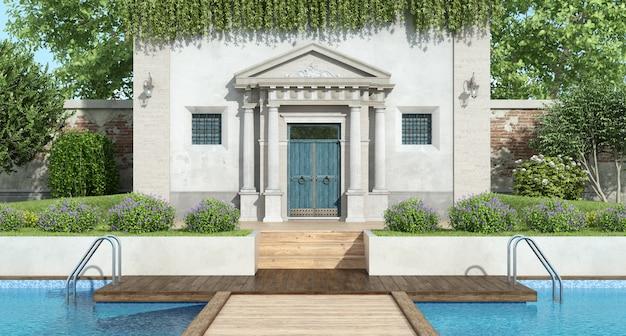 プール付きの豪華な庭園があるクラシックなヴィラ