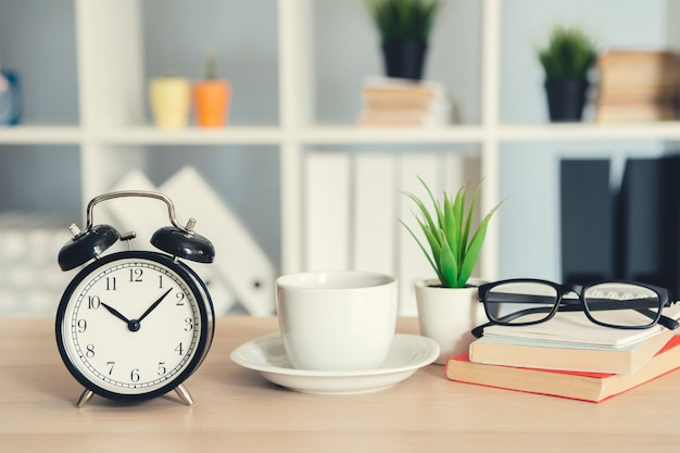 Classic vintage  alarm clock and  coffee cup