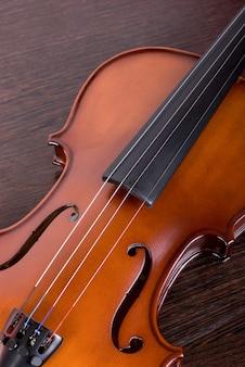 Classic violin closeup on a brown wood