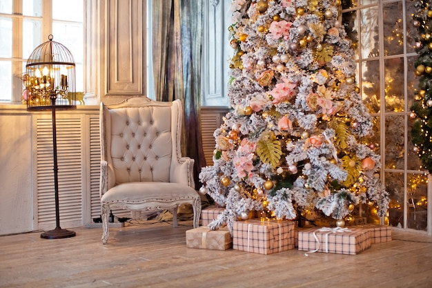 Classic white christmas interior. christmas tree decorated with presents and flashing garland