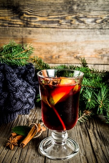 Classic winter autumn hot drink, mulled wine cocktail with  spices