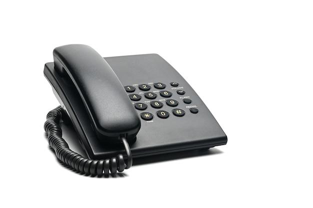 自宅やオフィスで使用される白のクラシックな有線電話。