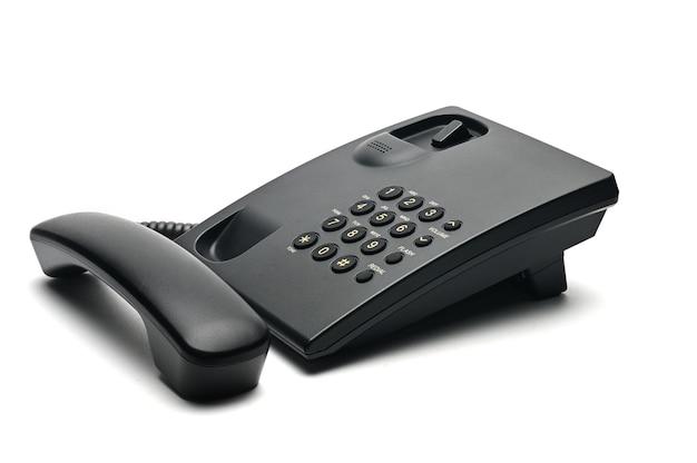 白地の家庭やオフィスで使用される古典的な有線電話 Premium写真