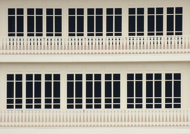 Classic wood window at a white concrete building