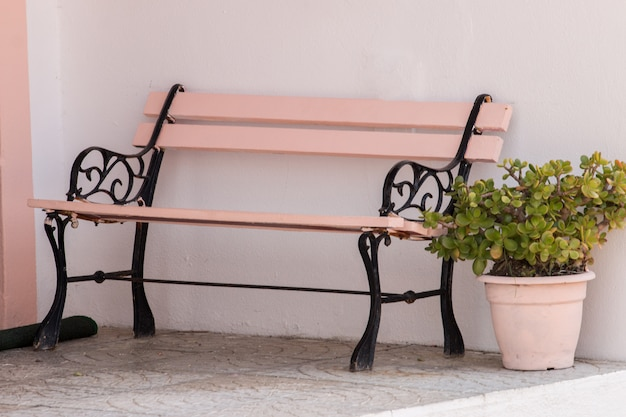 Classic wooden bench with flowerpot