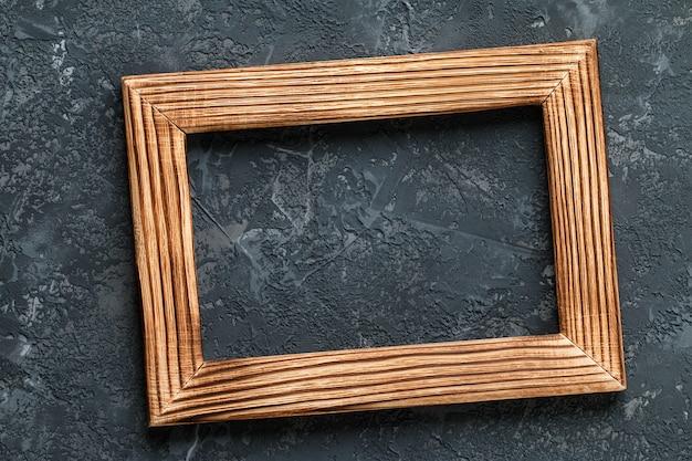 Classic wooden frame on dark stone.