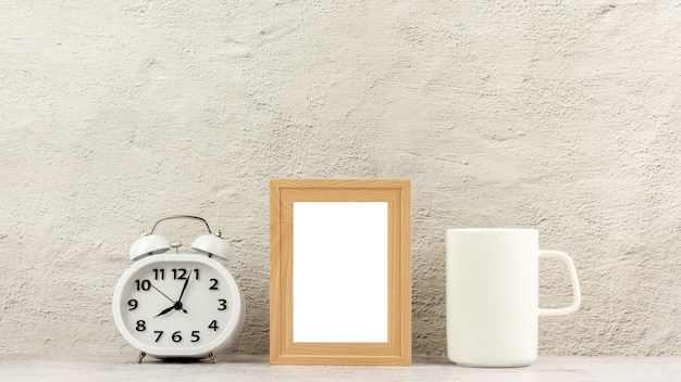 Classic wooden photo frame with a clock and a white coffee cup.