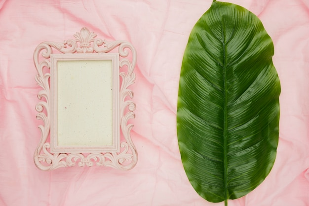 Classical frame template for wedding next to leaf