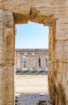 Classical greek temple at ruins of ancient city paestum, italy
