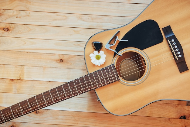 Classical guitar on a light brown background.