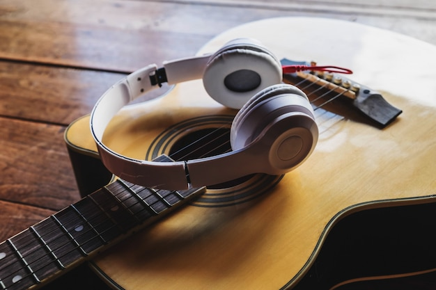 Classical guitar and music headphones