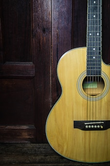 Classical guitar on old wooden