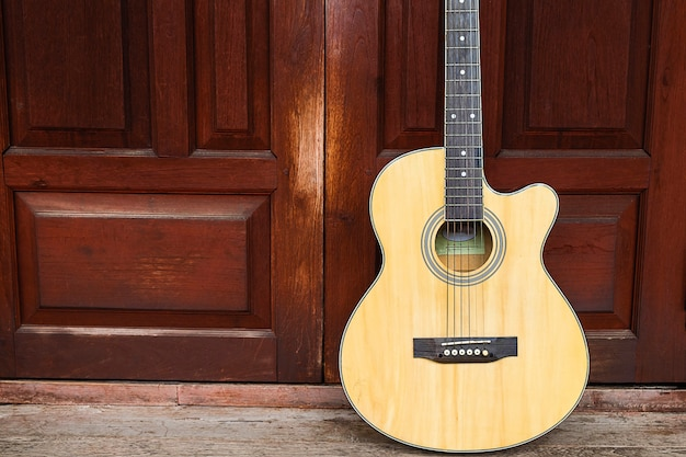 Classical guitar on wood