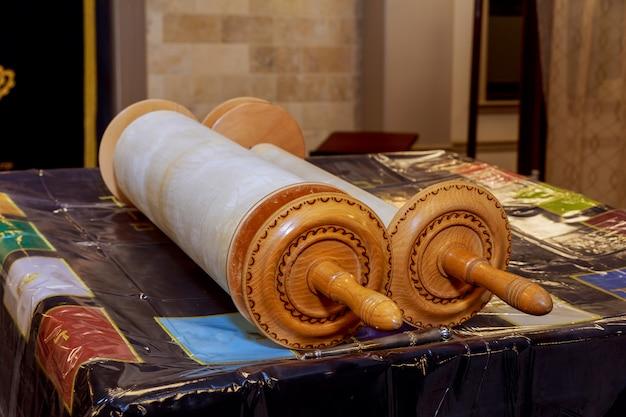 Classical torah scrolls in a blue case with hebrew letters. torah