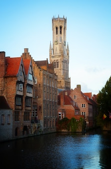 Classical view of old bruges with belfort tower, belgium, retro toned