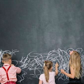 Classmates having fun with blackboard