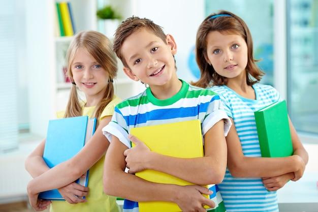 Classmates holding folders
