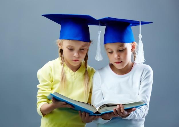 Classmates holding an open book