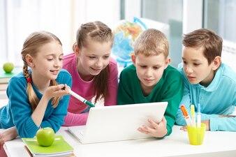 Classmates working together