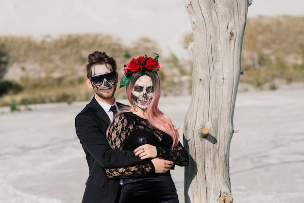 A classy couple with a skeleton make up for halloween or all souls day