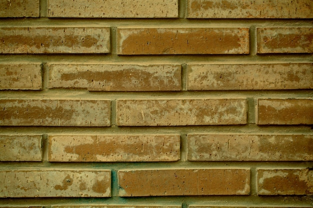 Clay brick wall  texture with a repeat pattern in neat rows for architectural concepts in a full frame view.