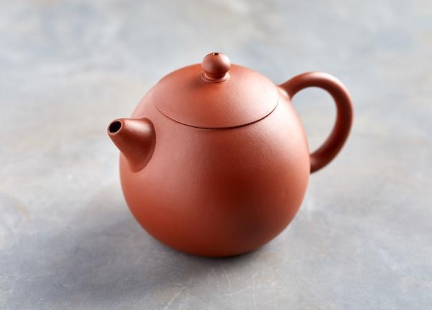 Clay chinese teapot Premium Photo