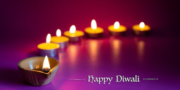 Clay diya lamps lit during dipavali, hindu festival of lights celebration