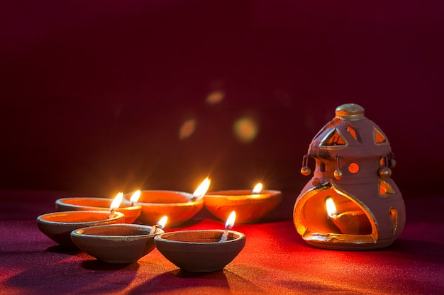 Clay diya lamps lit during diwali celebration. indian hindu light festival called diwali