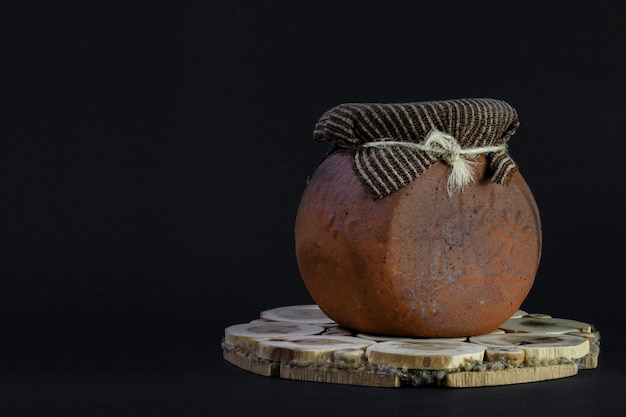 Clay pot with burlap isolated