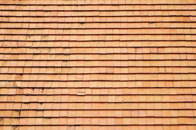 The clay roof tiles of a house in the countryside of thailand