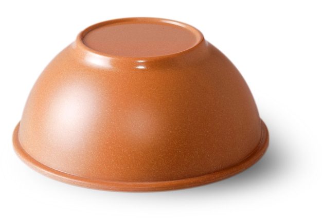 Clay saucer for products cut on the white surface