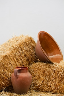 Clay utensils and straw haystack