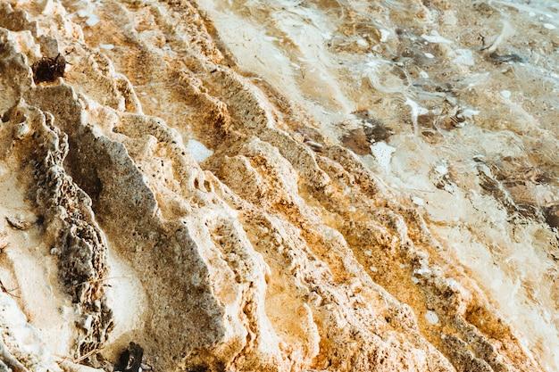粘土の黄色のテクスチャ石の背景