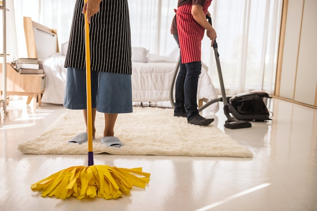 Clean bedroom by mop and vacuum cleaner