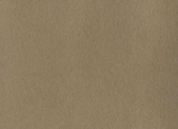 きれいな茶色のクラフト段ボール紙の背景テクスチャー。