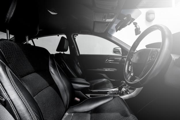 Clean console modern car, black indoor design.