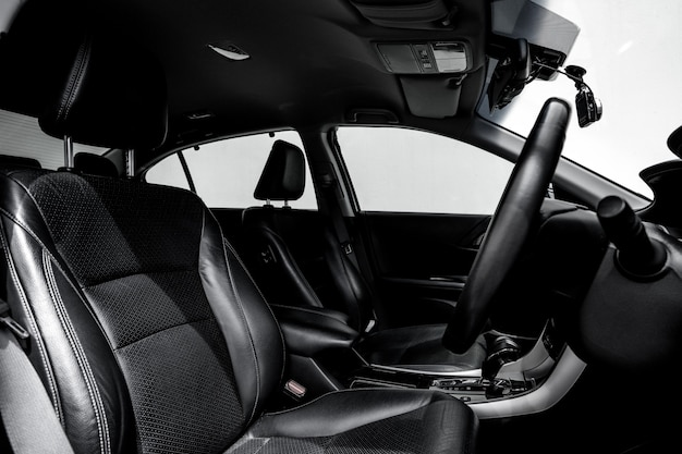 Clean console modern car, black indoor design.