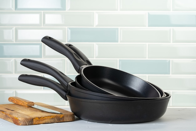 Clean and dry cooking pans on a kitchen counter