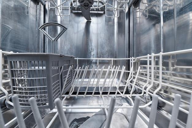 Clean empty dishwasher machine inside.