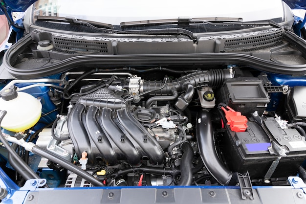 Clean engine compartment of a brand new car, with an engine capacity of 1600 millimeters