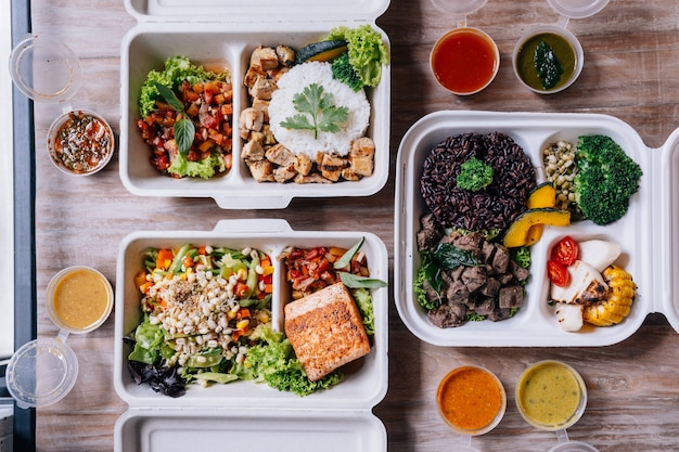 Clean food meal boxes: rice and rice berry with beef, salmon and chicken with vegetables a