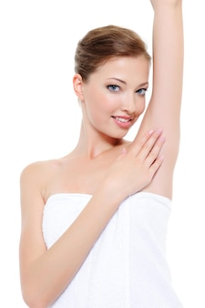 Clean and fresh skin of woman's underarm - white wall