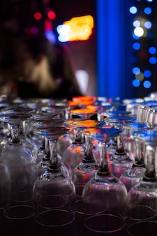 Clean glasses on the bar in a nightclub