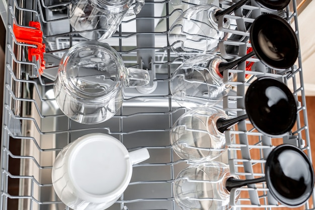 Clean glasses and cups in the basket after washing in the dishwasher.
