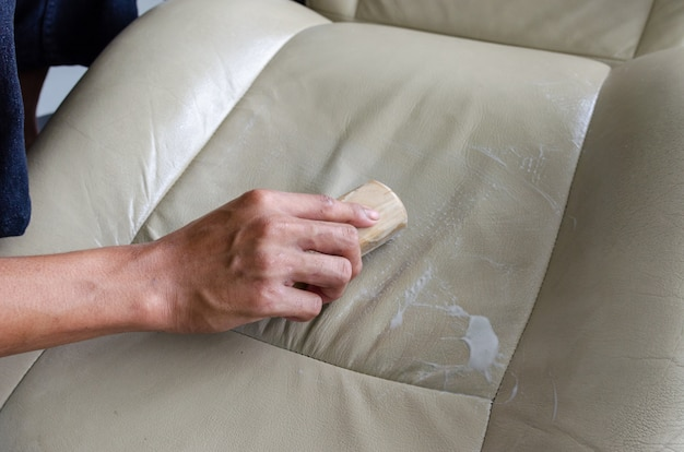 Clean the leather car seat.