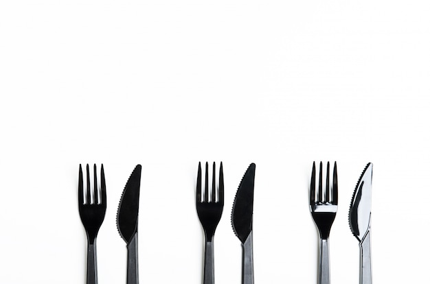 Clean plastic black forks and knives